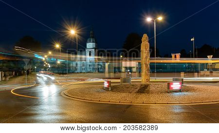 Roundabout and the church in Zory in the evening. Poland Europe.
