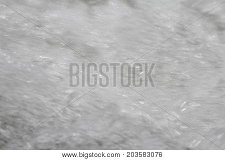 Water with foam caused by water velocity
