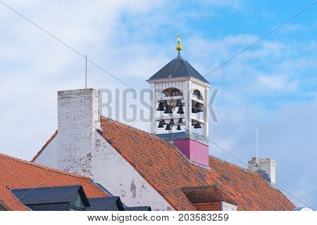 characteristic white church tower in Thorn the white village in the southern netherlands