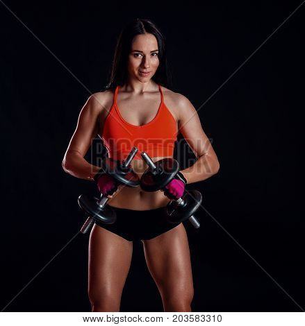 Nice Sexy Girl Doing Workout With Dumbbells Isolated Over Black Background. Athletic Young Woman Do