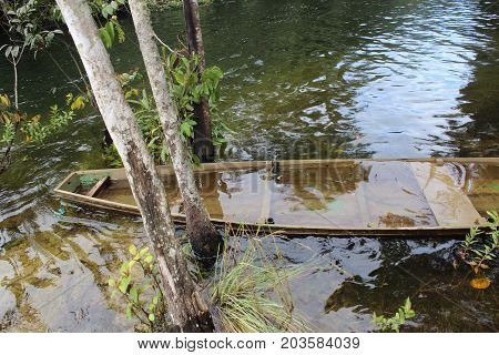A boat submerged in a calm river