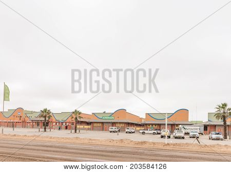 HENTIES BAY NAMIBIA - JUNE 29 2017: A street scene with a shopping centre in Henties Bay a holiday town on the Skeleton Coast of Namibia