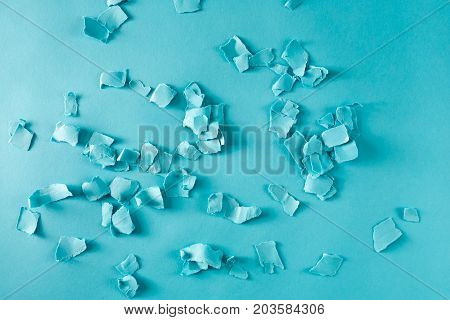 Scattered paper shreds on a blue background