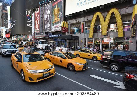 NEW YORK CITY USA - AUG. 24 : Yellow taxis on street in Manhattan on August 24 2017 in New York City NY. Manhattan is the most densely populated borough of New York City.