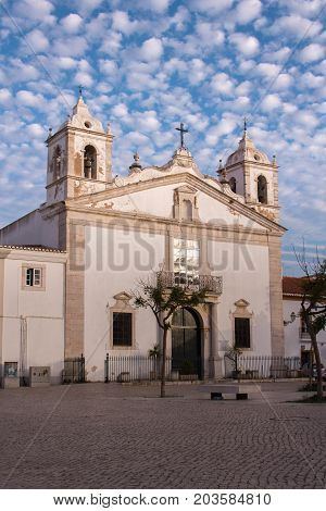 The church of Saint Mary Igreja Santa Maria in Lagos Portugal. Beautiful summer sky above with small white clouds. Christian church in Algarve region.