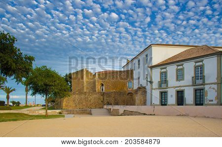 Castle of the governors Castelo dos Governadores in the city of Lagos Algarve Portugal. Blue summer sky with little white clouds.