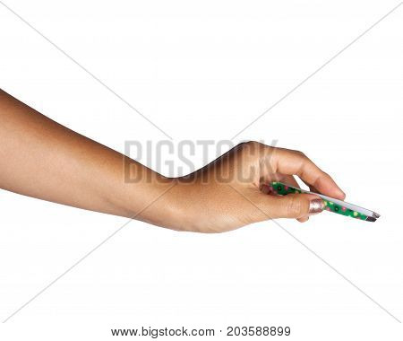 Close up of woman's hand holding an eyebrow tweezers.