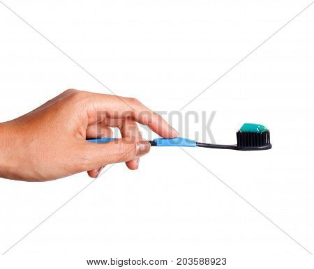 Female hand holding a Toothbrush with toothpaste isolated on white background
