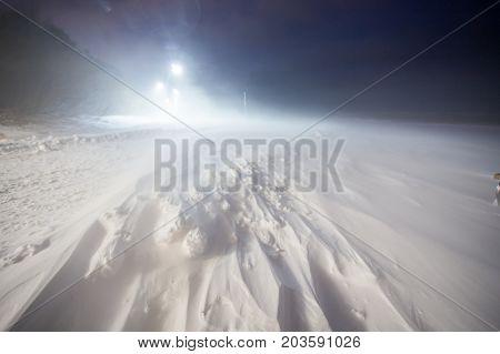 snowstorm at night street lights drifts coast sea