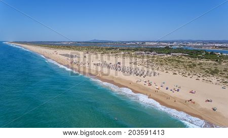 Aerial. Beach and tourists on the island Tavira. Algarve Portugal