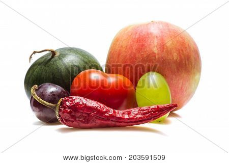 healthy vegetables and fruits of different varieties on a white background very appetizing