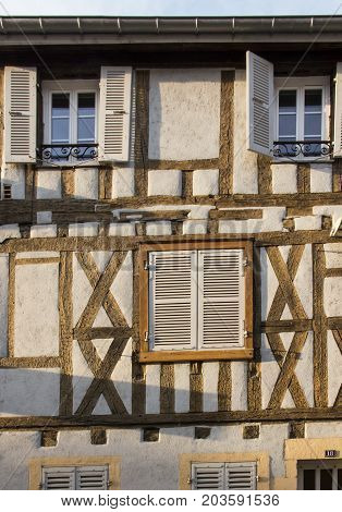 Old wall building with windows and shutters as a background