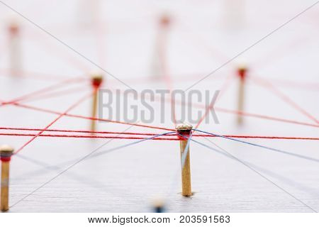 Background. Abstract concept of network, social media, internet, teamwork, communication. Nails linked together by threads