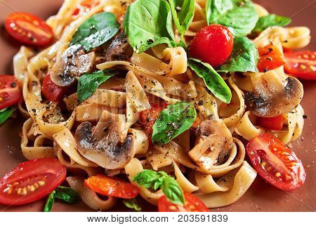 Home Made Vegan Pasta With Mushrooms, Tomatoes, Basil, Peppers And Aubergines - Served On Plate At W