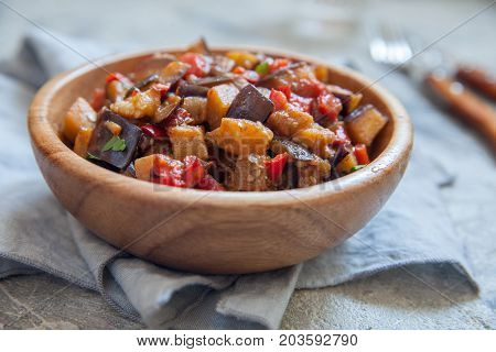 Eggplant stewed saute with fresh vegetables and herbs