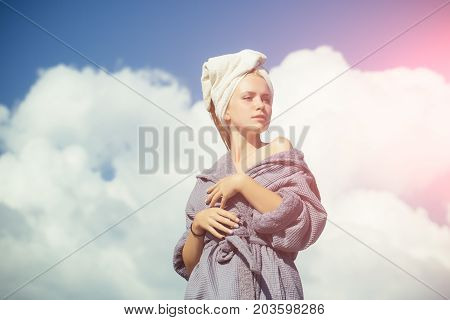 Girl Posing With Naked Shoulders On Cloudy Blue Sky