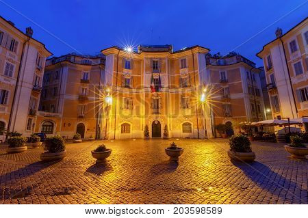 The square of St. Ignatius of Loyola and the facades of old buildings in the night illumination. Rome. Italy.