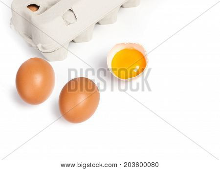 Chicken eggs in pulp egg carton isolated on white background
