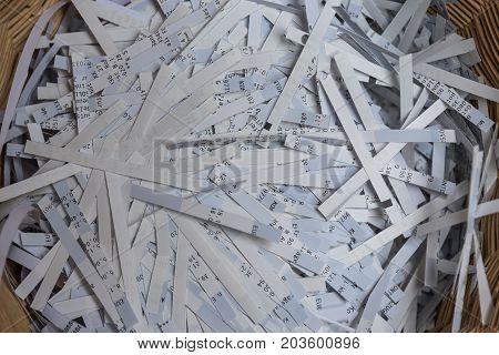 Shredder has destroyed strictly secret data - close up of paper shredder