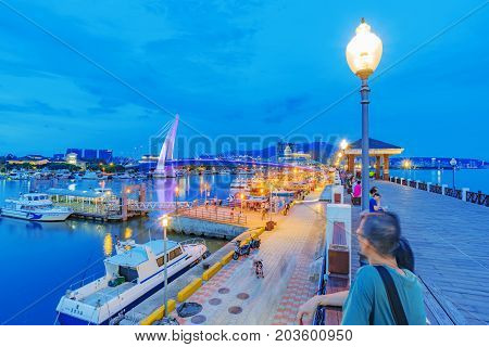 TAIPEI TAIWAN - JULY 05: This is an evening view a pier in the fisherman's wharf area of Tamsui where people come to enjoy the scenic views of the area on July 05 2017 in Taipei