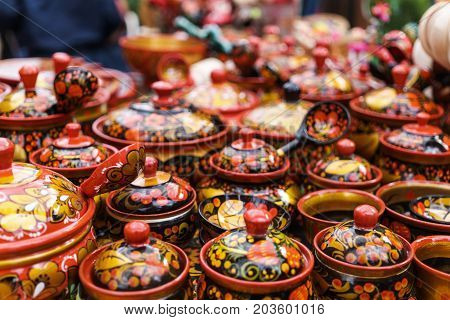 Handmade ware, traditional Russian decorative painting of wooden utensils - Khokhloma, selective focus