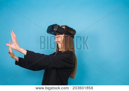 technology, virtual reality, entertainment and people concept - happy young woman with virtual reality headset or 3d glasses.