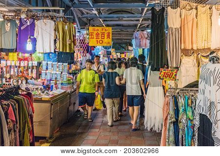 TAIPEI TAIWAN - JULY 02: This is a street in Jingmei night market where many locals come to shop. The shops sell clothes and other items at cheap prices on July 02 2017 in Taipei