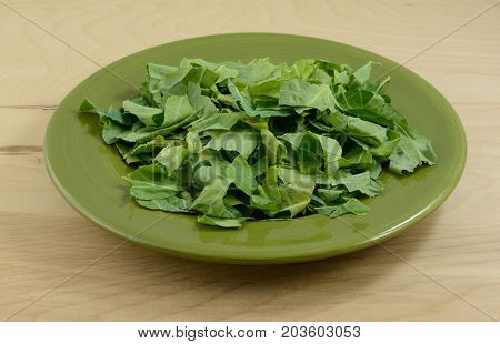 Chopped collard greens on plate as preparation for cooking