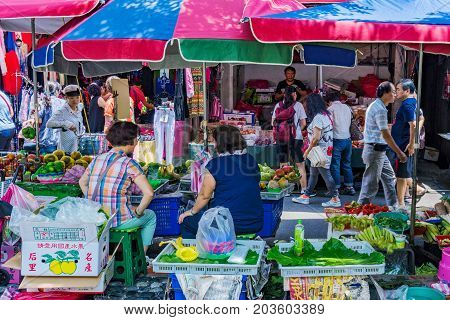 TAIPEI TAIWAN - JULY 01: Fruit and vegetable stalls in Shuanglian morning market a popular traditional market where pople come to buy local produce and other items on July 01 2017 in Taipei