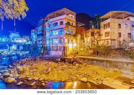 Riverside homes at night in rural village in Taiwan