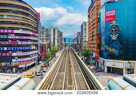 TAIPEI TAIWAN - JUNE 27: This is a view of the Zhongxiao Fuxing shopping areat with MRT station overground tracks on June 27 2017 in Taipei