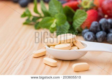 Multivitamin and mutimineral pills nutritional Supplement. closeup.