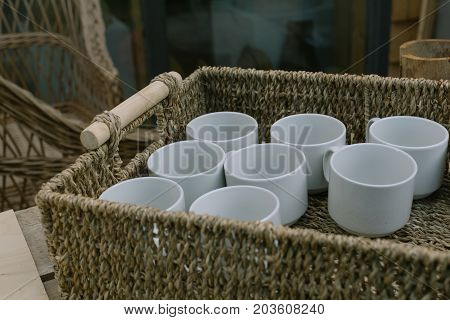 White cups in the basket. Object photo.