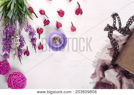 Flowers perfume shawl handbag on white wooden background