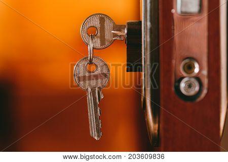 Keys in the door lock. Object photo.
