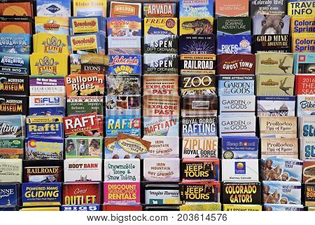 AUGUST 2017 -  WESTMINSTER, CO : Colorful Colorado Tourist Brochures arranged in a rack in a hotel lobby in Westminster, Co in Aug 2017