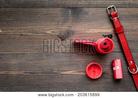 pet care and grooming tools with red dog-collar on wooden table background top view space for text