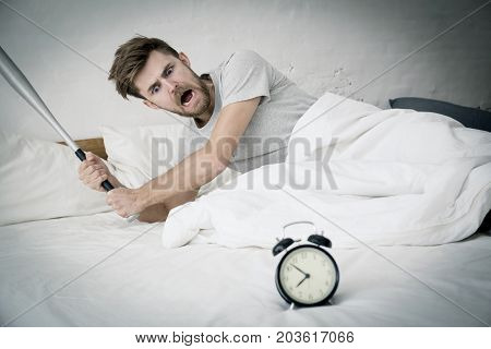 Portrait Upset Angry With Baseball Hit Young Man Screaming At Alarm Clock On Bedroom. Employee Runni