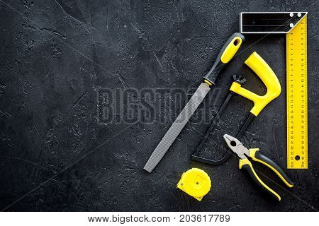 house renovation with implements set for building, painting and repair on black table background top view mockup