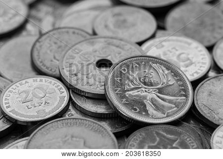 Set Of Coins From Different Countries Focus Of Canada Coins Black And White Color.
