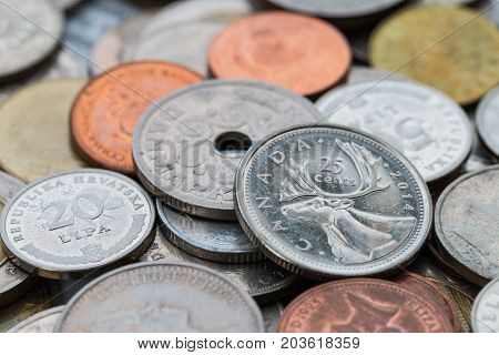 Set Of Coins From Different Countries Focus Of Canada Coins.