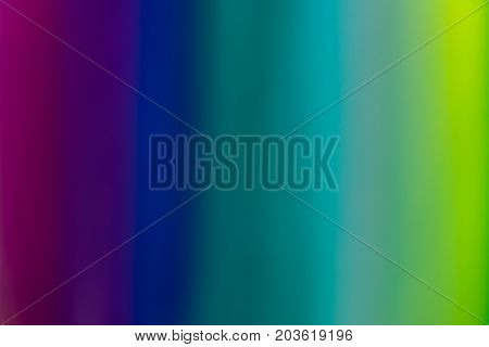 Intentionally blurred and defocused close-up of colorful textile threads pattern