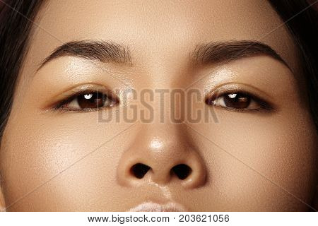 Beautiful Female Eye With Clean Skin, Daily Fashion Makeup. Asian Model Face. Perfect Shape Of Eyebr