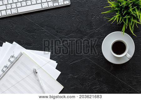 Desk of musician for songwriter work set with paper for notes on dark background top view mockup
