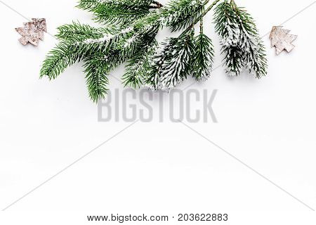 toys to decorate christmas tree for new year celebration with fur tree branches on white table background top veiw mockup