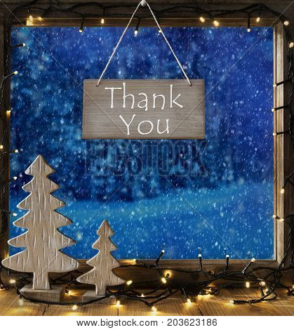 Sign With English Text Thank You. Window Frame With Winter Landscape With Snow. View To Snowy Trees Outside With Snowflakes. Christmas Tree And Fairy Lights.