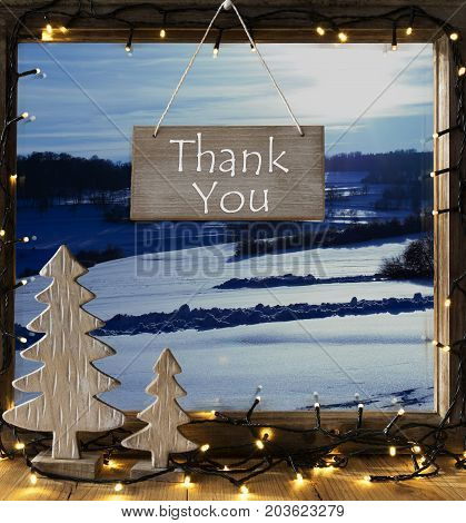Sign With English Text Thank You. Window Frame With Winter Landscape With Snow. View To Snowy Scenery Outside. Christmas Tree And Fairy Lights.