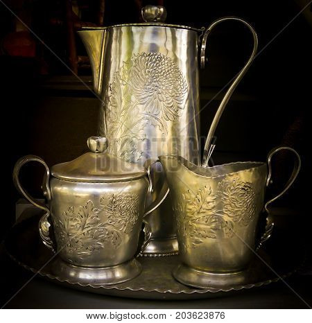 A coffee/tea serving set with the carafe sugar bowl cream cup and a serving tray.