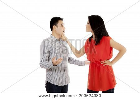 Picture of a young Asian couple arguing while quarreling in the studio isolated on white background