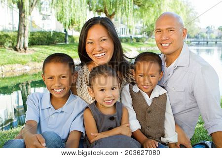 Portrait of a happy Asian family smiling.